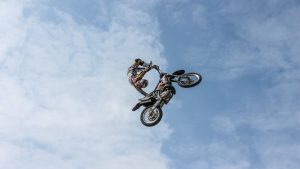 3840x2160 Wallpaper biker, motorcycle, extreme, trick, clouds, sky