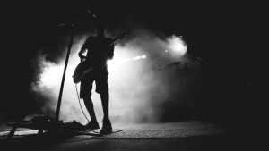 3840x2160 Wallpaper guitarist, musician, concert, microphone, performance, smoke, black and white