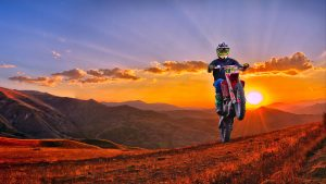 3840x2160 Wallpaper motorcycle, motorcyclist, cross, mountains, sunset, off-road