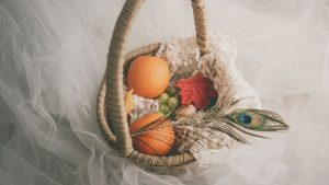 3840x2160 Wallpaper basket, fruit, leaves, feather