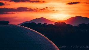 3840x2160 Wallpaper building, architecture, roof, sunset, mountains, trees