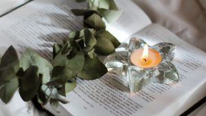 3840x2160 Wallpaper candle, branch, book