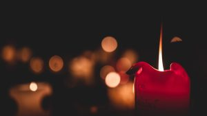 3840x2160 Wallpaper candle, flame, fire, red, blur, dark