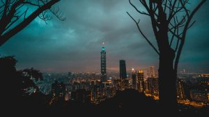 3840x2160 Wallpaper city, tower, cityscape, evening, lights, thunderclouds