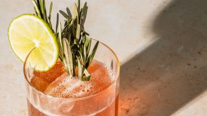 3840x2160 Wallpaper cocktail, glass, lime, rosemary, drink