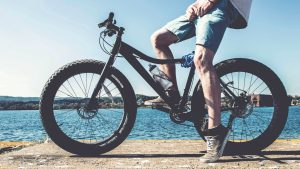 3840x2160 Wallpaper cyclist, legs, bicycle, river