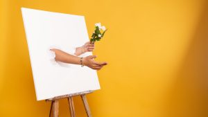 3840x2160 Wallpaper easel, canvas, hands, flowers, illusion, installation