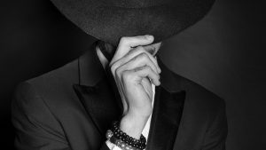 3840x2160 Wallpaper man, hat, hand, gesture, style, black and white