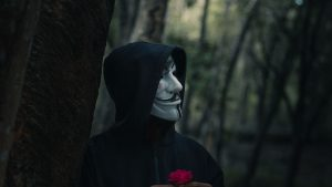 3840x2160 Wallpaper man, mask, hood, anonymous, forest