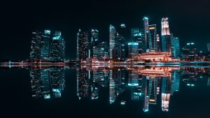 3840x2160 Wallpaper night city, buildings, reflection, lake, skyscrapers, lights, electricity