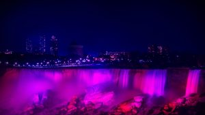 3840x2160 Wallpaper night city, waterfall, lights, stones, architecture, buildings