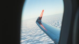 3840x2160 Wallpaper porthole, window, plane, wing, clouds, view