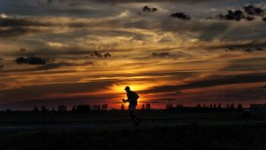 3840x2160 Wallpaper silhouette, running, sunset, athlete, clouds, sky
