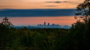 3840x2160 Wallpaper trees, city, twilight, view, tops, clouds
